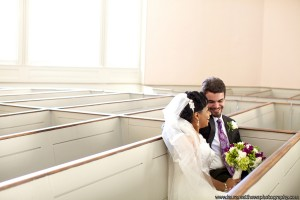 Bride and Groom in church sitting in pew