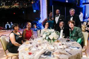 Sitting left to right  Sabrina Gross, Tierra Everett, Jackie Stone, B. K. Fulton, Amy Williams; Standing, left to right  Stephanie Gillard, David Gillard, Steve Williams